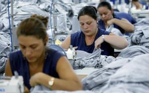 Employees work at a textile factory in San Pedro de Poas